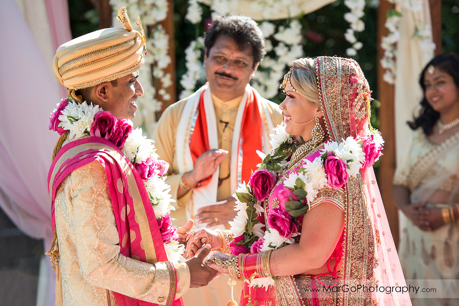bride and groom holdinh hands for final blessing  Aashirwad during Indian wedding ceremony at Elliston Vineyards in Sunol