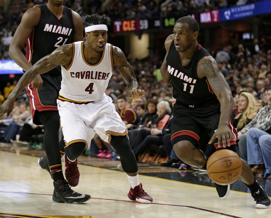 . Miami Heat\'s Dion Waiters (11) drive past Cleveland Cavaliers\' Iman Shumpert (4) in the second half of an NBA basketball game, Monday, March 6, 2017, in Cleveland. The Heat won 106-98. (AP Photo/Tony Dejak)