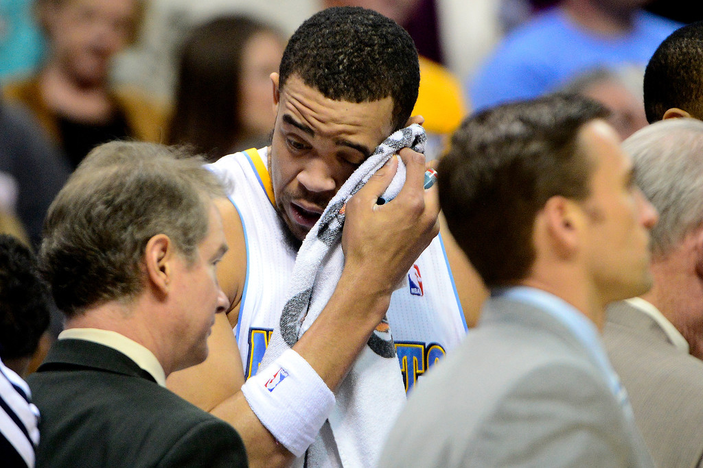. DENVER, CO - APRIL 14: JaVale McGee (34) of the Denver Nuggets wipes his face during the first half of action. The Denver Nuggets play the Portland Trail Blazers at the Pepsi Center. (Photo by AAron Ontiveroz/The Denver Post)