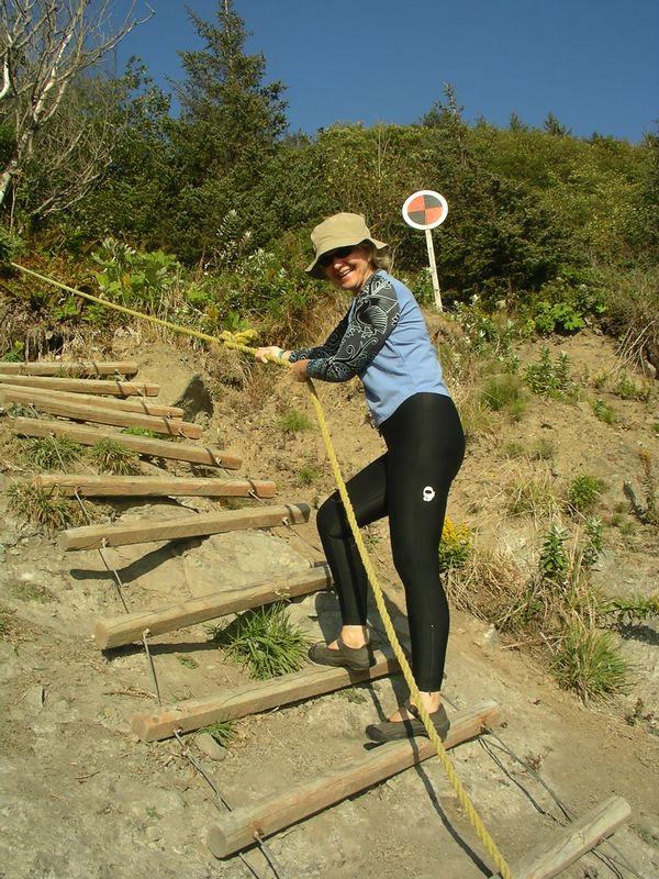 Susan climbing up the ladder.