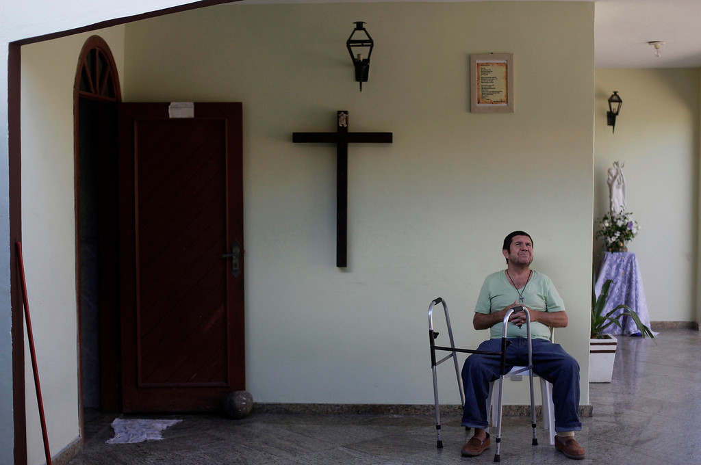 . Paulo Fernandes, who is homeless, sits in a house belonging to Franciscan fraternity O Caminho, where he has been living for two months, in the Campo Grande neighbourhood of Rio de Janeiro April 16, 2013. O Caminho (The Way), are a group of Franciscan monks and nuns who help the homeless on the streets of Rio de Janeiro. They consider the election of Pope Francis, the first pontiff to take the name of St Francis of Assisi, to be a confirmation of their beliefs in poverty and simplicity. In July, Pope Francis will visit Rio de Janeiro in his first international trip since assuming the papacy. Picture taken April 16, 2013. REUTERS/Ricardo Moraes