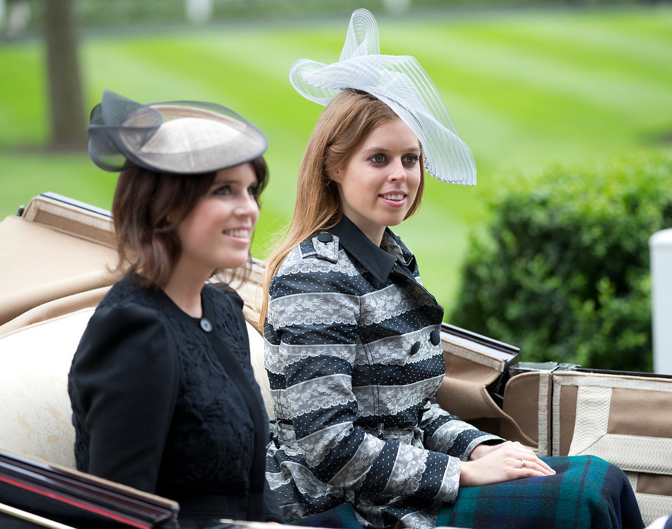 . Princesses Beatrice, right, looks at the crowd with her sister Eugene as they arrive by carriage for the first day of the Royal Ascot horse race meeting in Ascot, England, Tuesday, June 18, 2013. (AP Photo/Alastair Grant)
