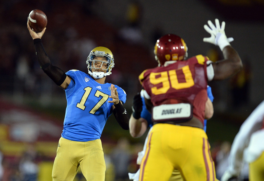 . UCLA�s Brett Hundley #17 passes the ball during their game against USC at the Los Angeles Memorial Coliseum Saturday, November 30, 2013.  (Photo by Hans Gutknecht/Los Angeles Daily News)