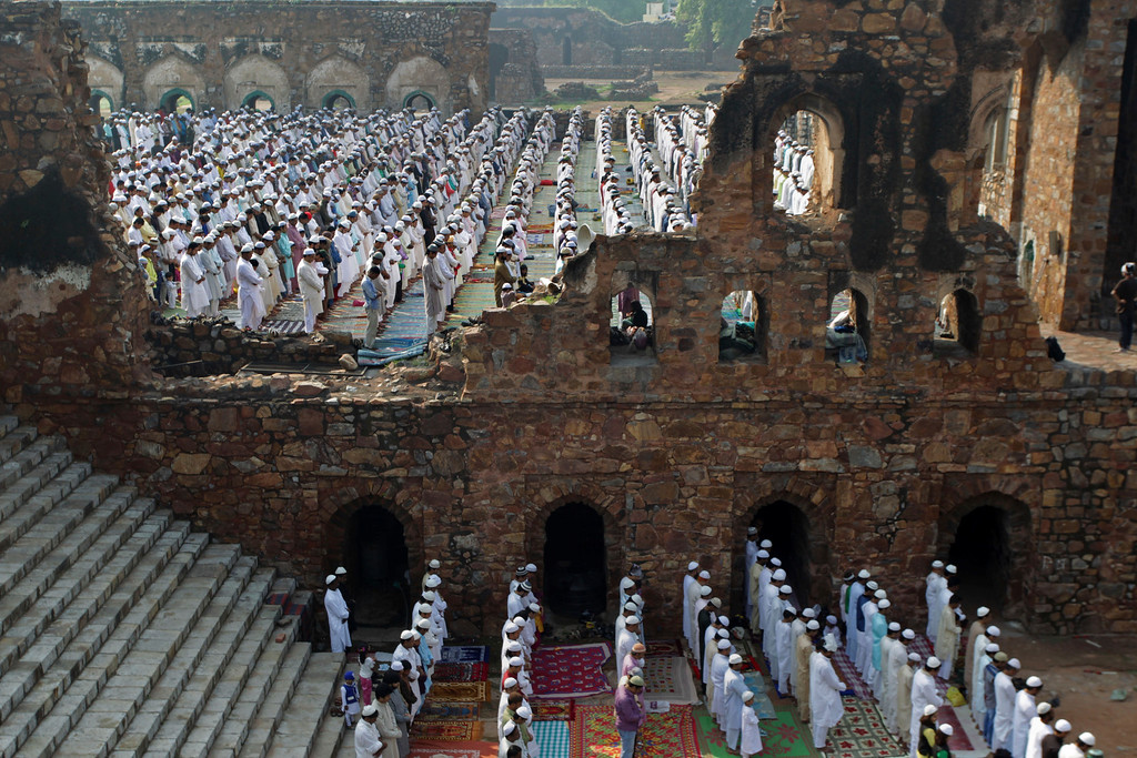 . India Muslims offer prayers at the Ferozshah Kotla Mosque during Eid al-Adha in New Delhi, India, Wednesday, Oct. 16, 2013.  (AP Photo/Tsering Topgyal)