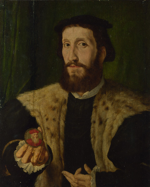 A Man holding a Coloured Medal