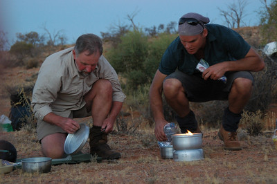 Mr. Hill and Mr. G. sort out cooking their meals for the evening.