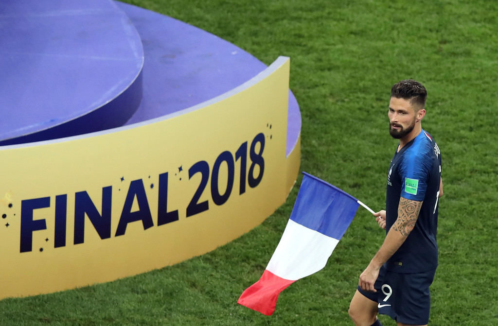 . France\'s Olivier Giroud carries a French flag celebrating at the end of the final match between France and Croatia at the 2018 soccer World Cup in the Luzhniki Stadium in Moscow, Russia, Sunday, July 15, 2018. (AP Photo/Thanassis Stavrakis)
