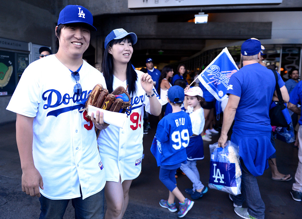 . Sungmin Boo, 29, and Sunhee Chun, 28, both of Torrance, shop before the Dodgers vs Brave\'s game 3 of the NLDS at Dodger Stadium, Sunday, October 6, 2013. (Photo by Sarah Reingewirtz/Los Angeles Daily News)
