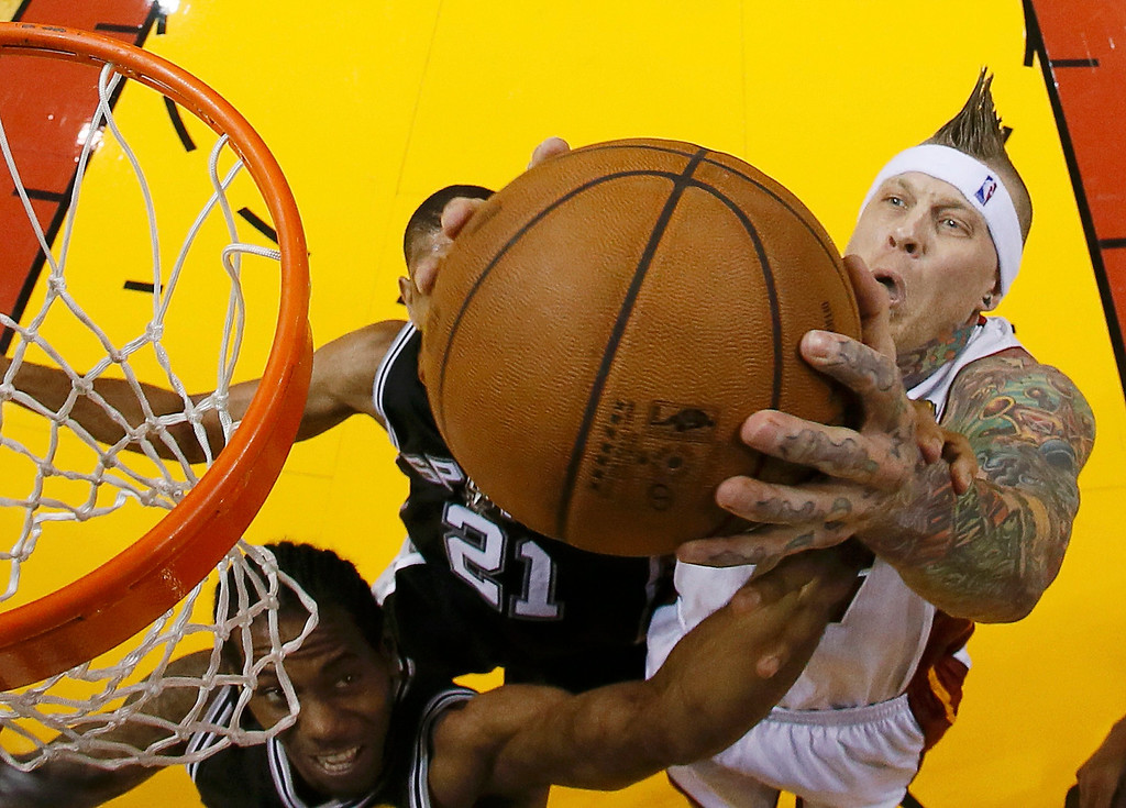 . Miami Heat power forward Chris Andersen (11) goes to the basket past San Antonio Spurs power forward Tim Duncan (21) and San Antonio Spurs small forward Kawhi Leonard (2) during Game 6 of their NBA Finals basketball playoff in Miami, Florida June 18, 2013. REUTERS/Kevin C. Cox/Pool