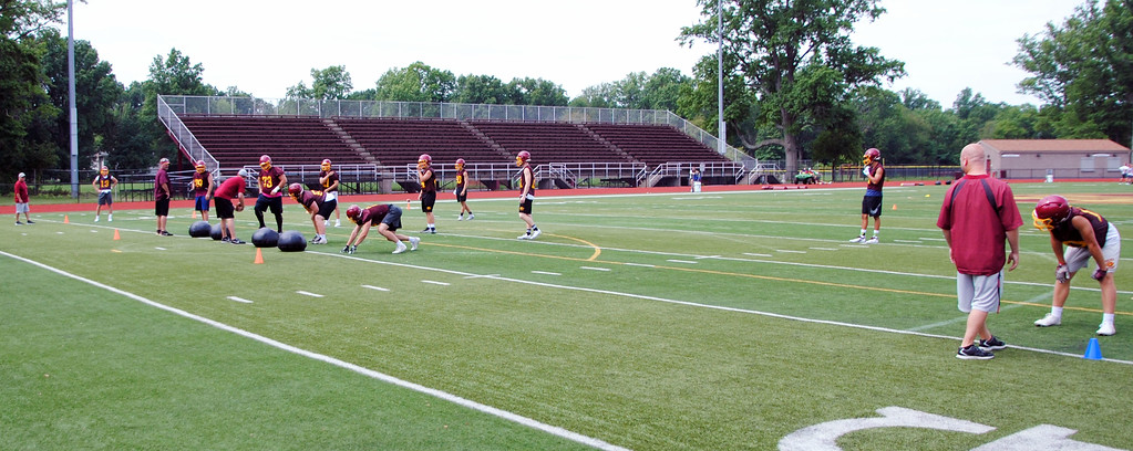 . Jon Behm - The Morning Journal<br> Scenes from Avon Lake\'s first day of football practice on July 30.