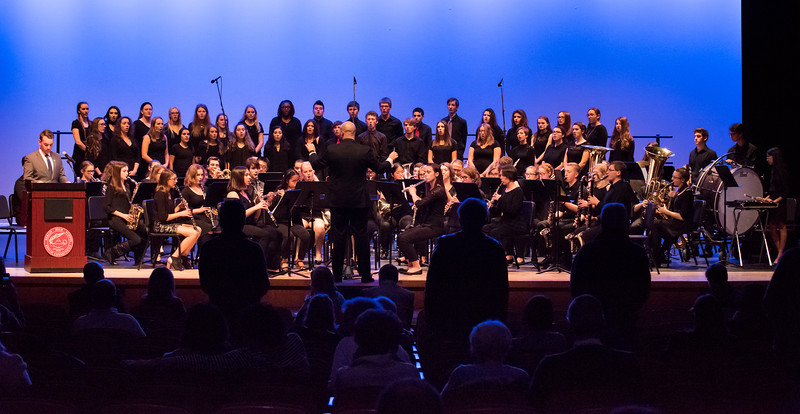 11/8/17  Wesley Bunnell | Staff  The Berlin Public Schools held a Veterans Day Program titled Remembering Our History and Recognizing the Sacrifices of Our Veterans on Thursday evening at the Berlin High School auditorium.  The Berlin High School Band and Choral Singers performs a musical selection Armed Forces - The Pride of America! as members of the different branches stand as their branches music is played. Army veterans can be seen silhouetted against the stage.