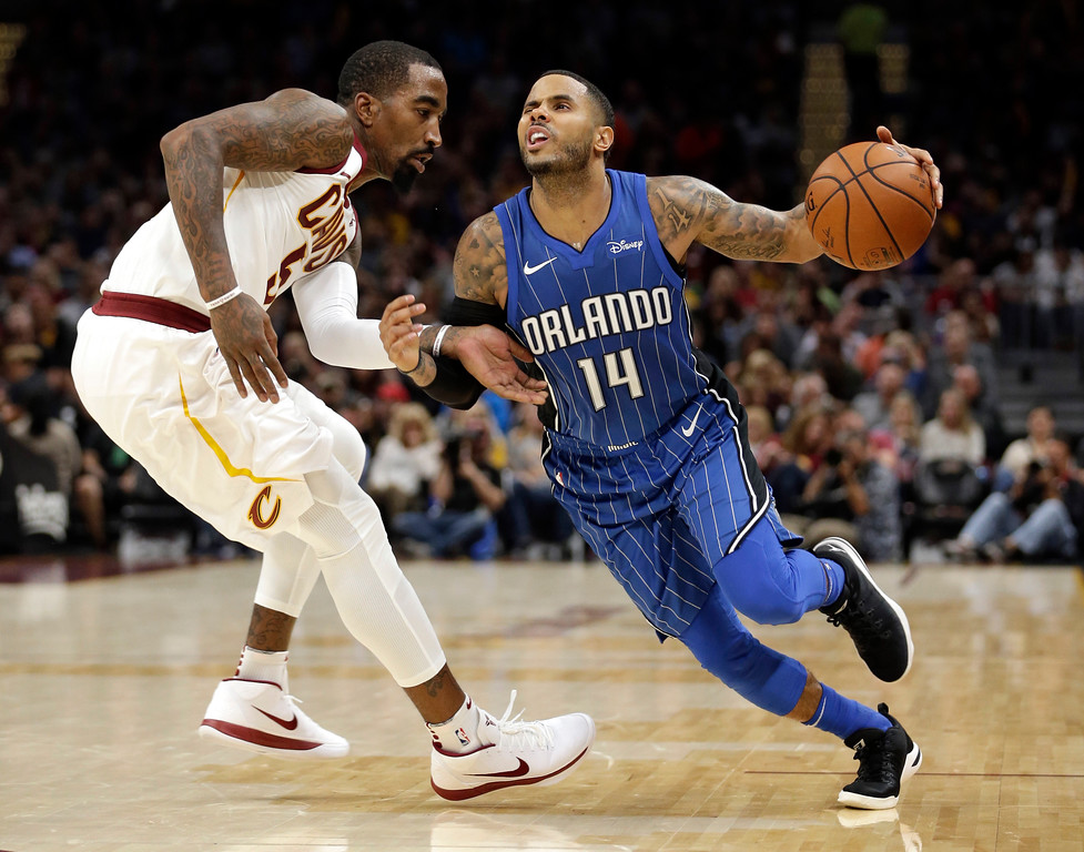 . Orlando Magic\'s D.J. Augustin drives past Cleveland Cavaliers\' JR Smith in the second half of an NBA basketball game, Saturday, Oct. 21, 2017, in Cleveland. (AP Photo/Tony Dejak)