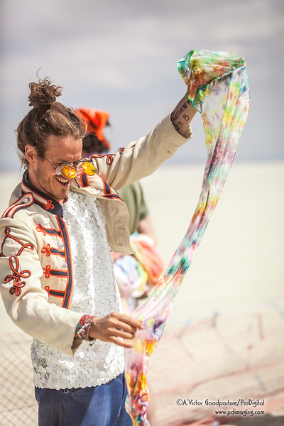 At one of the farthese points within Burning Man, an art car set up a tie dye actitvity.