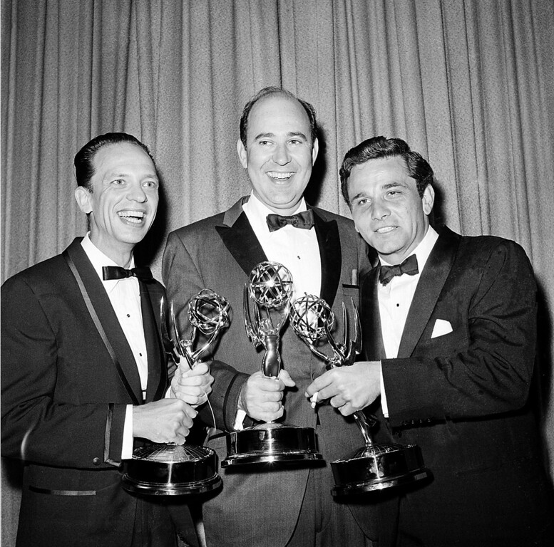""". Writer Carl Reiner, center, poses with actors Don Knotts, left, and Peter Falk as they hold their statuettes at the Emmys Awards in Hollywood, Ca., May 22, 1962.  Knotts was named outstanding performance in a supporting role by an actor in \""""The Andy Griffith Show\""""; Reiner won outstanding writing achievement in comedy for the \""""Dick Van Dyke Show\""""; and Falk was named outstanding single performance by an actor in a leading role in \""""The Dick Powell Show, The Price of Tomatoes.\""""  (AP Photo)"""