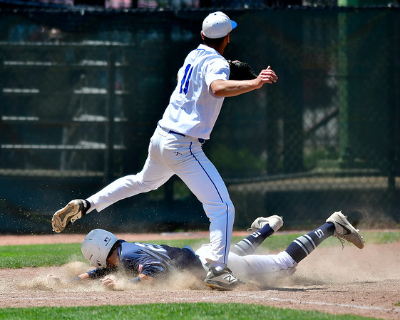 6/8/2019 Mike Orazzi | Staff Staples High School's Kevin Rabac ?(21) scores as Southington's Jason Krar?(10) covers home during the Class LL State Baseball Tournament at Palmer Field In Middletown on Saturday.