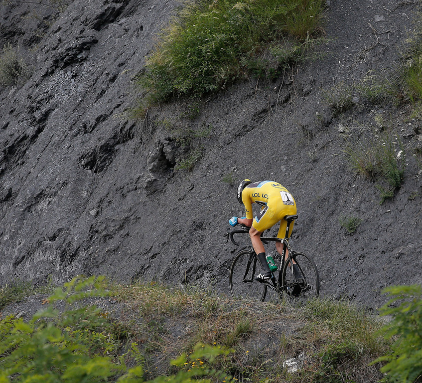 . Stage winner Christopher Froome of Britain, wearing the overall leader\'s yellow jersey, rides during the seventeenth stage of the Tour de France cycling race an individual time trial over 32 kilometers (20 miles) with start in Embrun and finish in Chorges, France, Wednesday July 17, 2013. (AP Photo/Christophe Ena)