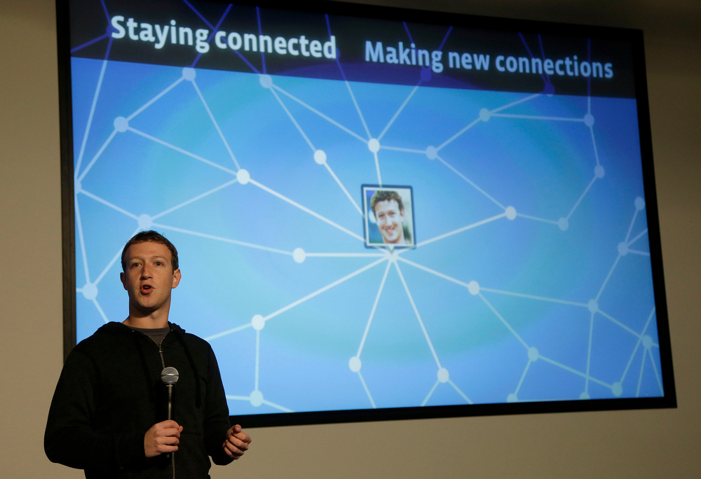 Description of . Facebook CEO Mark Zuckerberg speaks about Facebook Graph Search at a Facebook headquarters in Menlo Park, Calif., Tuesday, Jan. 15, 2013.  The new service lets users search their social connections for information about their friendsí interests, and for photos and places.  (AP Photo/Jeff Chiu)