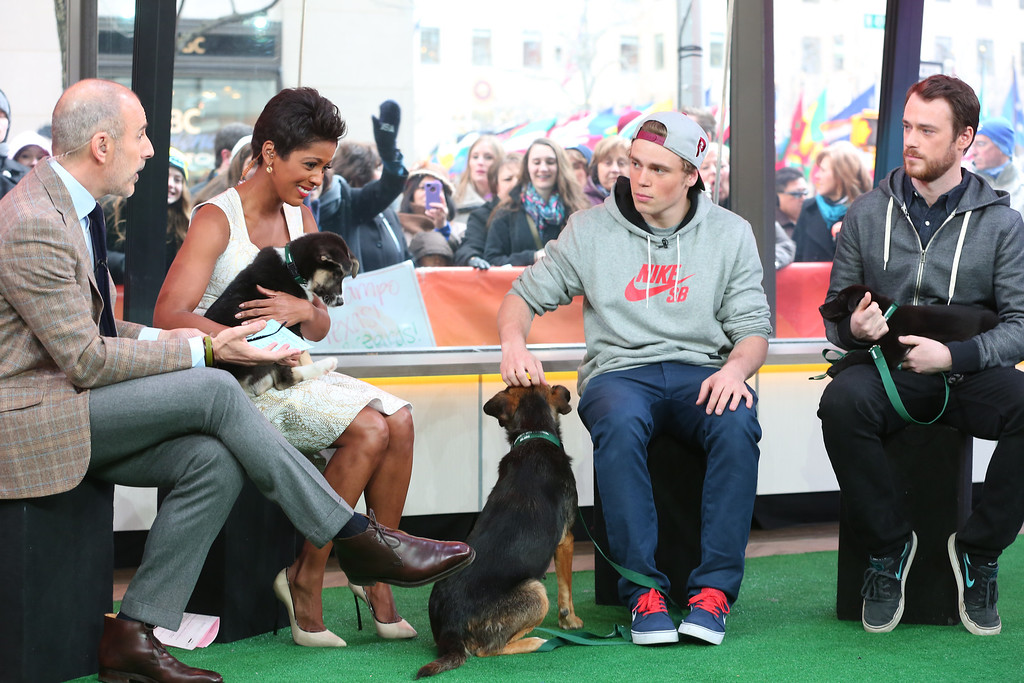 . In this image released on Friday, March 14, 2014, Sochi Dogs make an appearance on the Today Show with owners Winter Olympic silver medalist Gus Kenworthy and Robin Macdonald. Humane Society International has been working with Macdonald and Kenworthy for the past several weeks to transport the dogs from Sochi, Russia, to the United States. (Christopher Lane/AP Images for Humane Society International)