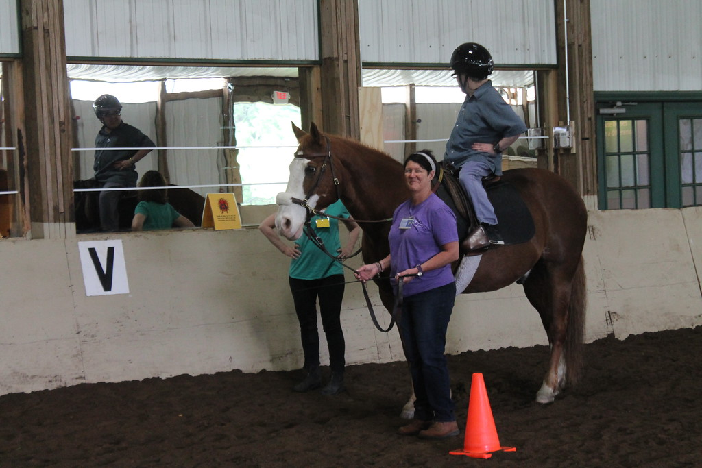 . Dan Matthews,  a client  Willoughby Branch checks out his reflection in the mirror while stopped at one of the stations in the riding arena that helps participants in the equine therapy program develop coordination  and other skills  while riding. Kristi Garabrandt - The News-Herald