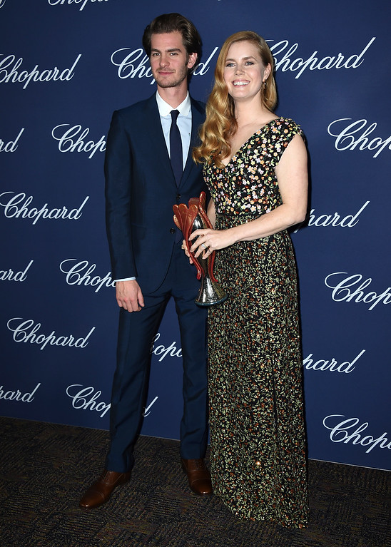 ". Amy Adams, winner of the Chairman\'s award for ""Arrival,\"" poses backstage with presenter Andrew Garfield at the 28th annual Palm Springs International Film Festival Awards Gala on Monday, Jan. 2, 2017, in Palm Springs, Calif. (Photo by Jordan Strauss/Invision/AP)"