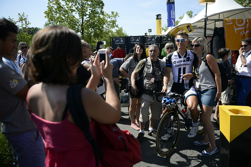 . Supporters take a picture with Germany\'s Marcel Kittel (2ndR) at the departure village in Saint-Etienne prior to the start of the 197.5 km thirteenth stage of the 101st edition of the Tour de France cycling race on July 18, 2014 between Saint-Etienne and Chamrousse, central eastern France.  (LIONEL BONAVENTURE/AFP/Getty Images)