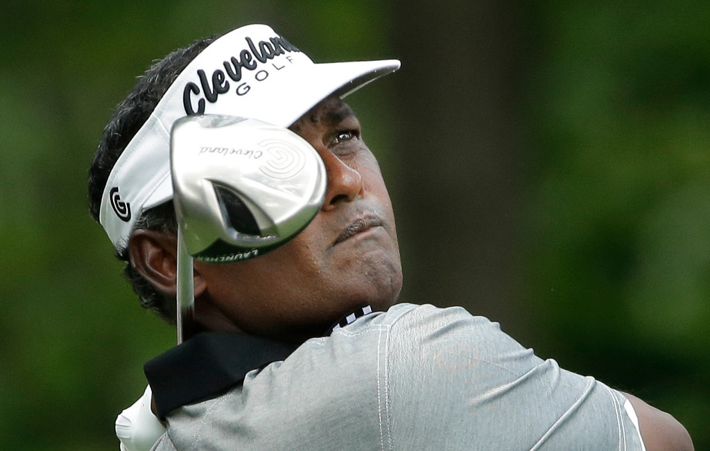 . Vijay Singh, of Fiji, watches his tee shot on the eighth hole during the first round of the PGA Championship golf tournament at Oak Hill Country Club, Thursday, Aug. 8, 2013, in Pittsford, N.Y. (AP Photo/Charlie Riedel)