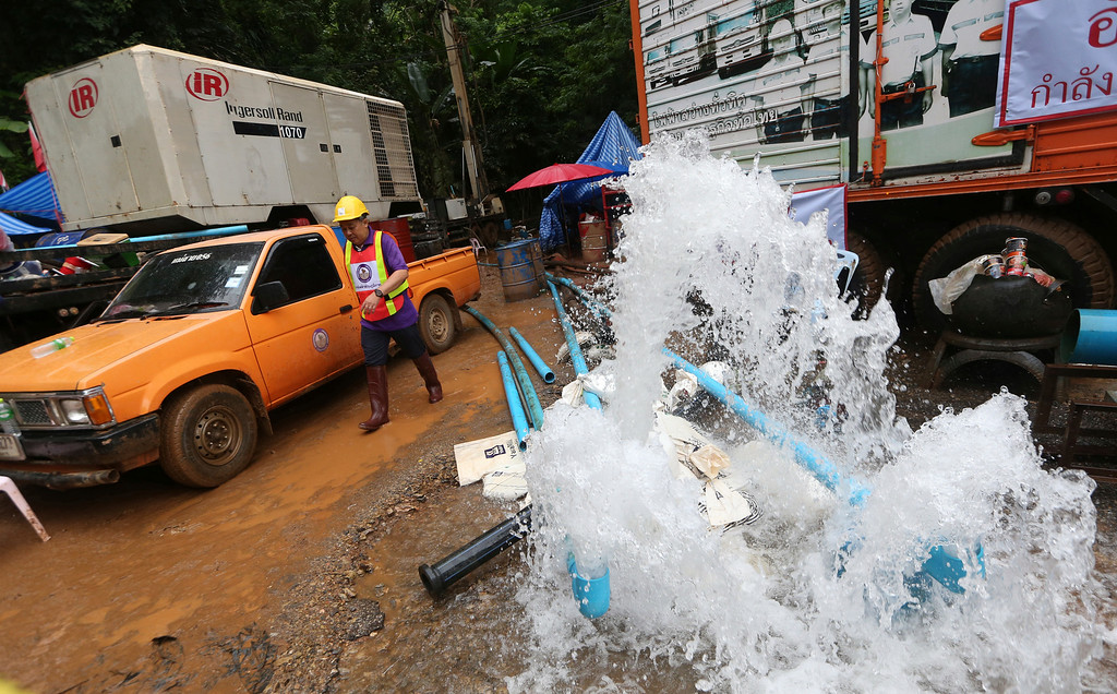 . In this Tuesday, July 3, 2018, file photo, water is pumped from the flooded cave where 12 boys and their soccer coach were found alive in Mae Sai, Chiang Rai province, northern Thailand. (AP Photo/Sakchai Lalit, File)