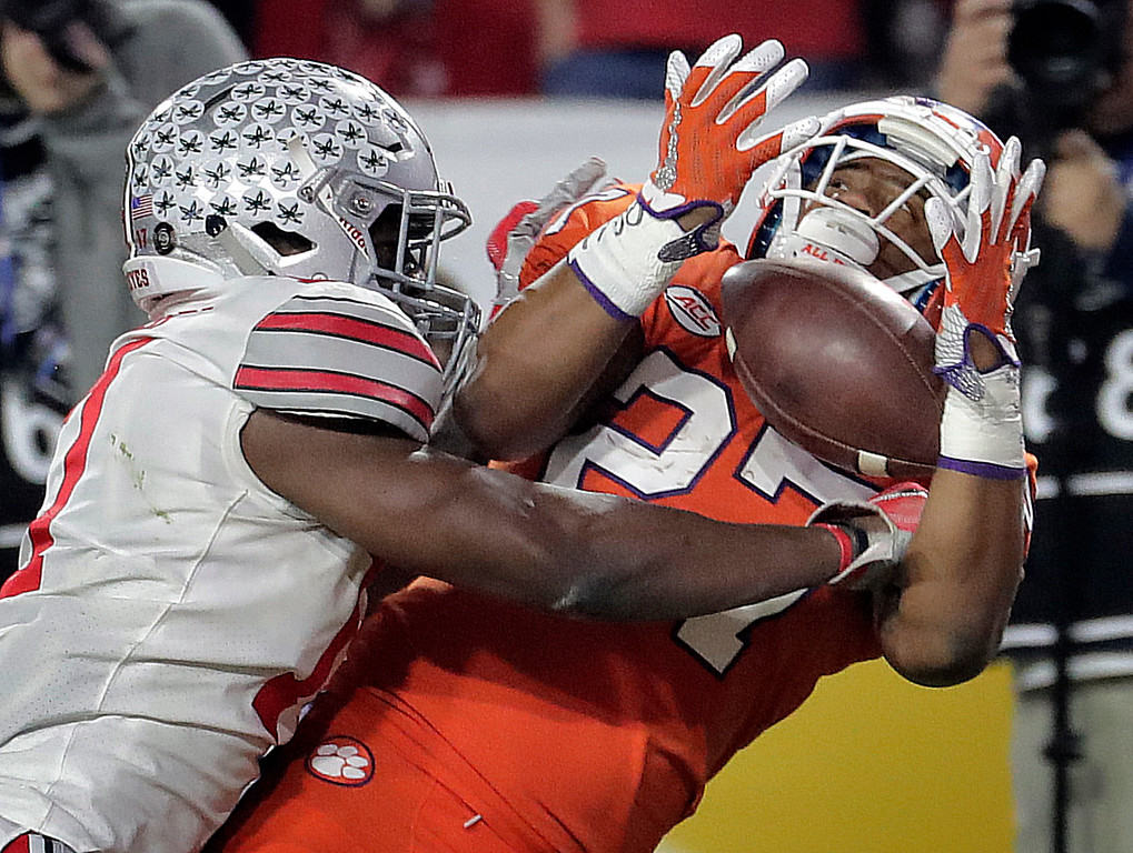 . Clemson running back C.J. Fuller (27) pulls in a touchdown pass as Ohio State cornerback C.J. Saunders, left, defends during the first half of the Fiesta Bowl NCAA college football playoff semifinal, Saturday, Dec. 31, 2016, in Glendale, Ariz. (AP Photo/Rick Scuteri)