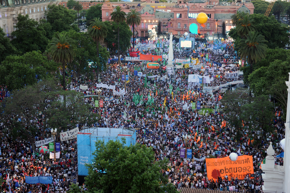 . Supporters of Argentina\'s President Cristina Fernandez de Kirchner fill the Plaza de Mayo, on December 9, 2012, during a rally on the eve of the Day of Democracy and Human Rights, called by the government to celebrate the 29th anniversary of the return to democracy in Argentina.  DANIEL GARCIA/AFP/Getty Images