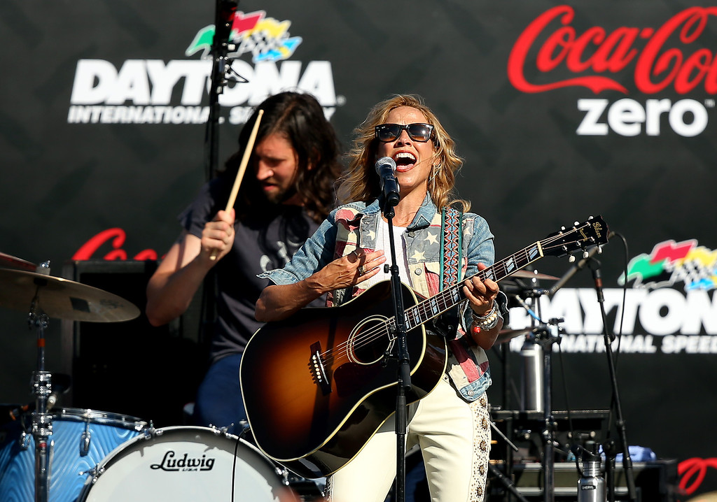 . DAYTONA BEACH, FL - JULY 06:  Sheryl Crow performs prior to the NASCAR Sprint Cup Series Coke Zero 400 at Daytona International Speedway on July 6, 2013 in Daytona Beach, Florida.  (Photo by Mike Ehrmann/Getty Images)