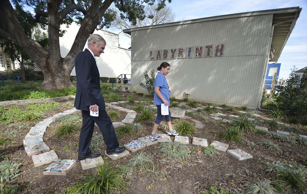 . LONG BEACH, CALIF. USA -- Sixth grader Susan Mirzazadeh gives a tour of the school\'s Labyrinth to California Superintendent of Public Instruction Tom Torlakson at Hughes Middle School on February 15, 2013, in Long Beach, Calif. Torlakson was at the school to announce  the 2013 nominees � four schools and one school district � to compete in the second year of the U.S. Department of Education�s Green Ribbon School. Photo by Jeff Gritchen / Los Angeles Newspaper Group