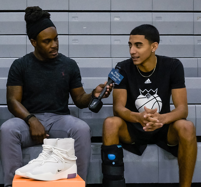 Danny Valentin, a shooting guard on Wellington High School's boys basketball team talks to Palm Beach Post reporter Wilkine Brutus about the new Nike Fear of God 1 Light Bone sneakers, donated to the Wellington High School boys and girls basketball teams by  fashion designer Jerry Lorenzo on Wednesday, January 16, 2019 at Wellington High School, in Wellington, Florida. Lorenzo, founder of streetwear label Fear of God, donated the sneakers to the Wellington High School boys and girls basketball teams. Each pair costs $350.00. [JOSEPH FORZANO/palmbeachpost.com]