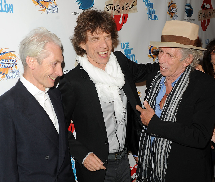 """. Musician Charlie Watts, singer Mick Jagger, and musician Keith Richards attend the re-release of The Rolling Stones\' \""""Exile on Main St.\"""" album at The Museum of Modern Art on May 11, 2010 in New York City.  (Photo by Stephen Lovekin/Getty Images)"""