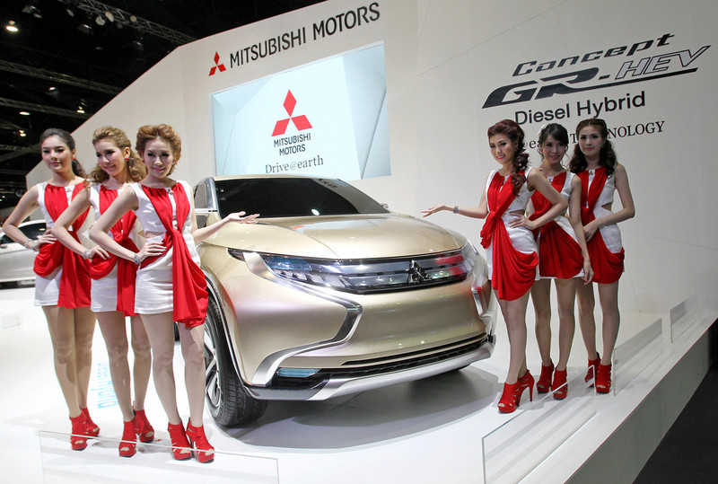 . Thai models pose next to Mitsubishi Motors\' GR-HEV concept SUV designed with diesel-electric hybrid power train on the press day of the Bangkok Motor Show in Bangkok, Thailand, Tuesday, March 26, 2013. The 34th running of the show is opened to the public from Wednesday. (AP Photo/Sakchai Lalit)