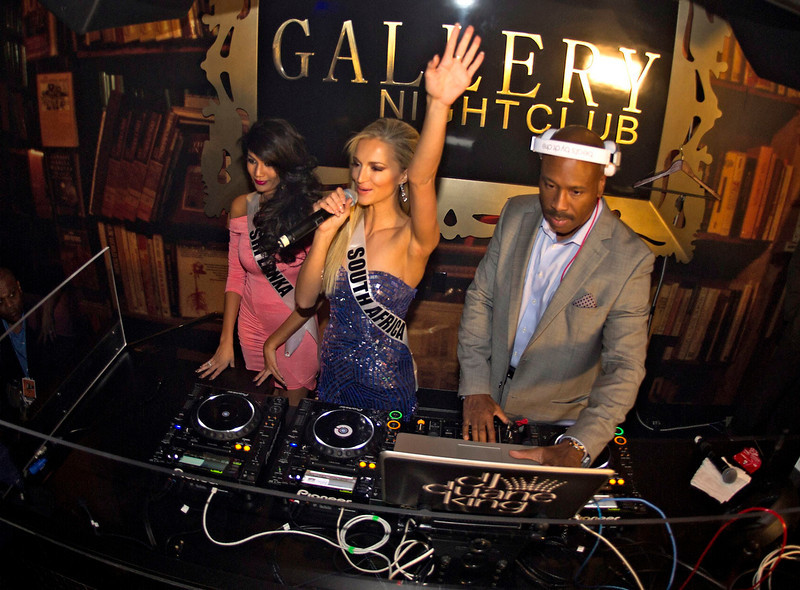 . Miss South Africa Melinda Bam (C), Miss Sri Lanka Sabrina Herft (L) and DJ Duane King stand by the decks at the Gallery Club at Planet Hollywood in Las Vegas, Nevada December 9, 2012. The 89 contestants from around the world will spend the next few weeks touring, filming, rehearsing, and making new friends while they prepare to compete for the coveted Miss Universe crown. REUTERS/Matt Brown/Miss Universe Organization L.P/Handout