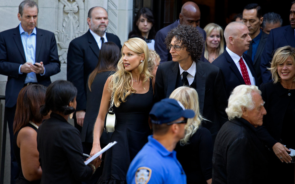 . Howard Stern, center right, and his wife Beth depart a funeral service for comedian Joan Rivers at Temple Emanu-El in New York Sunday, Sept. 7, 2014. Rivers died Thursday at 81. (AP Photo/Craig Ruttle)