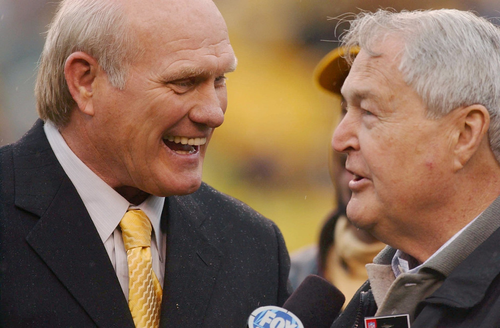 . Pittsburgh Steelers Hall of Fame quarterback Terry Bradshaw, left, and former coach Chuck Noll chat before the Steelers game against the St. Louis Rams, Sunday, Oct. 26, 2003, in Pittsburgh. The two were among other former Steelers greats who took part in a celebration in honor of the Steelers playing the 1000th game in their history Sunday. The Steelers lost to the Rams, 33-21. (AP Photo/Carolyn Kaster)