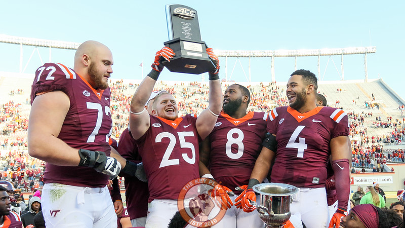 Sam Rogers holds up the ACC Coastal Division Champion trophy. (Mark Umansky/TheKeyPlay.com)