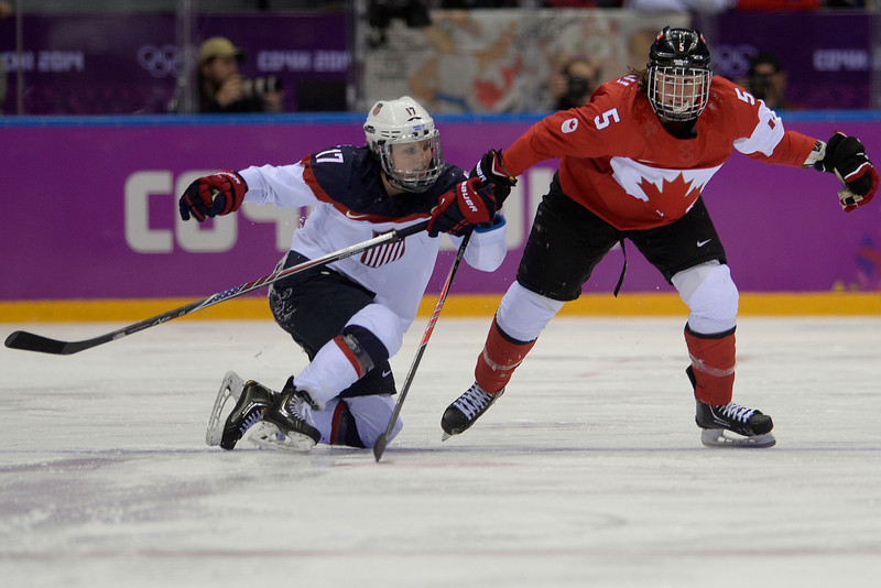 . Jocelyne Lamoureaux (17) of the U.S.A. holds Lauriane Rougeau (5) of the Canada during the third period of the women\'s gold medal ice hockey game. Sochi 2014 Winter Olympics on Thursday, February 20, 2014 at Bolshoy Ice Arena. (Photo by AAron Ontiveroz/ The Denver Post)