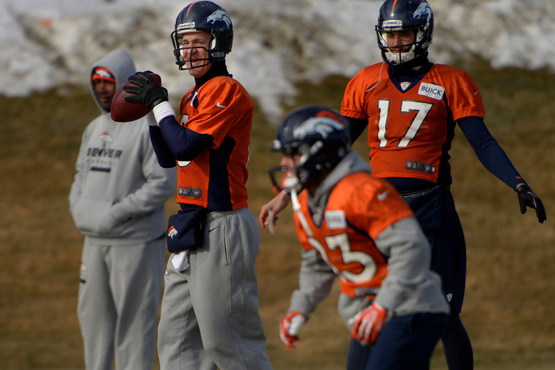 . Quarterback Peyton Manning #18 of the Denver Broncos eyeing wide receiver Wes Welker #83 during practice at Dove Valley in Centennial January 10, 2014 Centennial, Colorado. (Photo by Joe Amon/The Denver Post)