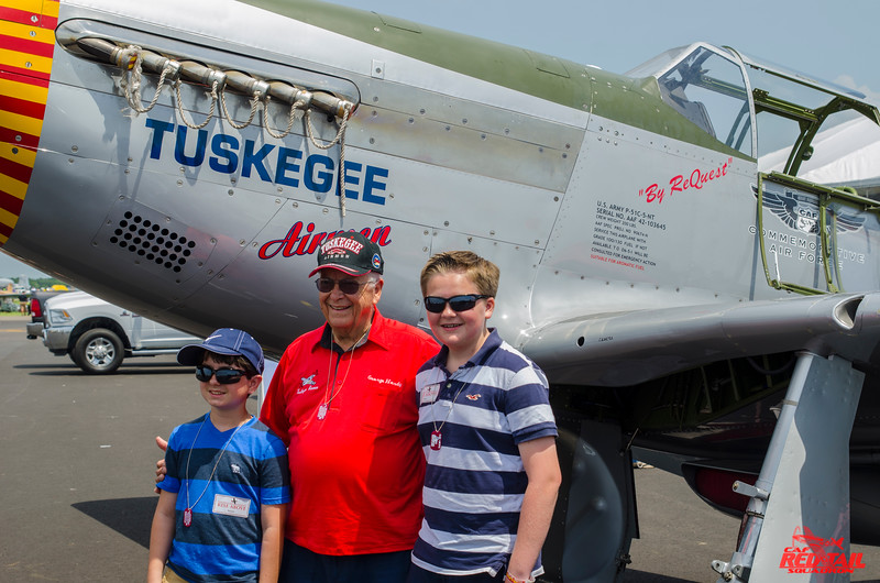 2 young volunteers with Lt. Col. Hardy.