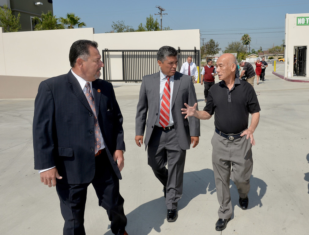 . Irwindale Mayor Mark Breceda, left, and City Councilman Julian Miranda , center, tour the Huy Fong Foods plant with CEO David Tran on Tuesday May 27, 2014. A team from Governor Jerry Brown�s Office of Business and Economic Development joins the tour of the 650,000 square-foot facility that the council voted has created a public nuisance. (Photo by Keith Durflinger/Whittier Daily News)