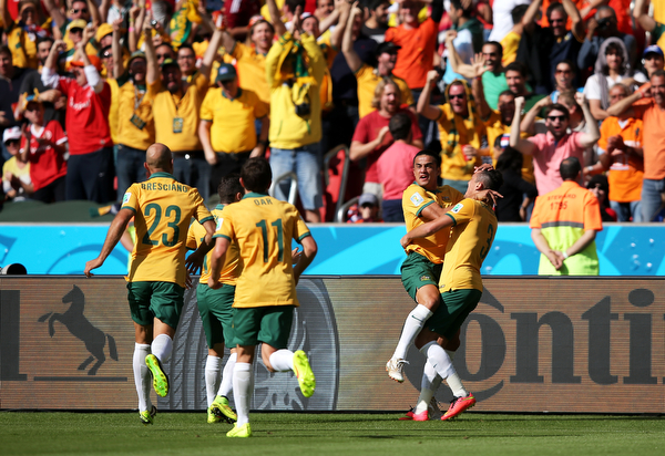 . Tim Cahill of Australia (2nd R) celebrates with teammates after scoring his team\'s first goal during the 2014 FIFA World Cup Brazil Group B match between Australia and Netherlands at Estadio Beira-Rio on June 18, 2014 in Porto Alegre, Brazil.  (Photo by Dean Mouhtaropoulos/Getty Images)