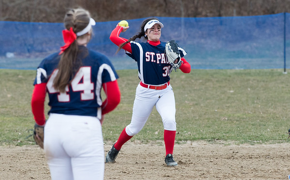 04/02/19 Wesley Bunnell | Staff St. Paul softball defeated Ansonia at home on Tuesday afternoon. Jessica Persechino (30) ranges towards third to field and throw to first on a ground ball.