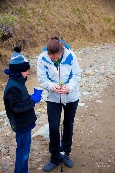 Havre Daily News/Floyd Brandt  Montana Fish and Wildlife gave a short lecture on how to catch fish and provided fishing-poles for Lincoln-McKinley 3rd grade classes at Beaver Creek Reservoir. Fisherman and 3rd Grade Teacher Glenda Stickel puts the worm on the hook for her student Brayden Nimmiek.