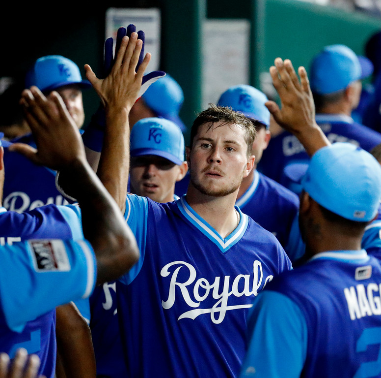 . Kansas City Royals\' Ryan O\'Hearn is congratulated in the dugout after hitting a solo home run during the ninth inning of the team\'s baseball game against the Cleveland Indians on Friday, Aug. 24, 2018, in Kansas City, Mo. The Royals won 5-4. (AP Photo/Charlie Riedel)