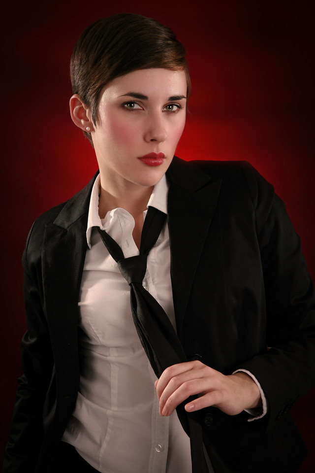 Female Fashion Model Low Key Portrait with Dark Red Background, Mysterious Mood