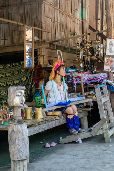 "Kayan woman of the ""long neck"" tribe.  Baan Tong Luang Hill Tribe Village, Thailand"