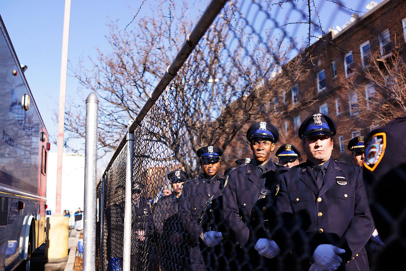 . Police officers from around the country pause outside of Christ Tabernacle Church during the funeral of slain New York City Police Officer Rafael Ramos, one of two officers murdered while sitting in their patrol car in an ambush in Brooklyn last Saturday afternoon on December 27, 2014 in the Glenwood section of the Queens borough of New York City. Thousands of fellow officers, family, friends and Vice President Joseph Biden are expected at the church in the Glendale neighborhood of Queens for the funeral.  (Photo by Spencer Platt/Getty Images)