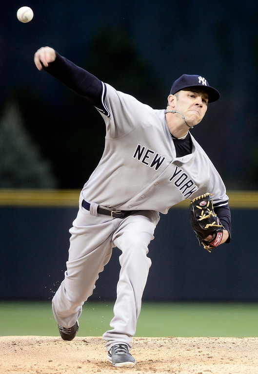 . New York Yankees\' David Phelps pitches against the Colorado Rockies during their inter-league MLB baseball game in Denver, Colorado May 8, 2013.   REUTERS/Mark Leffingwell